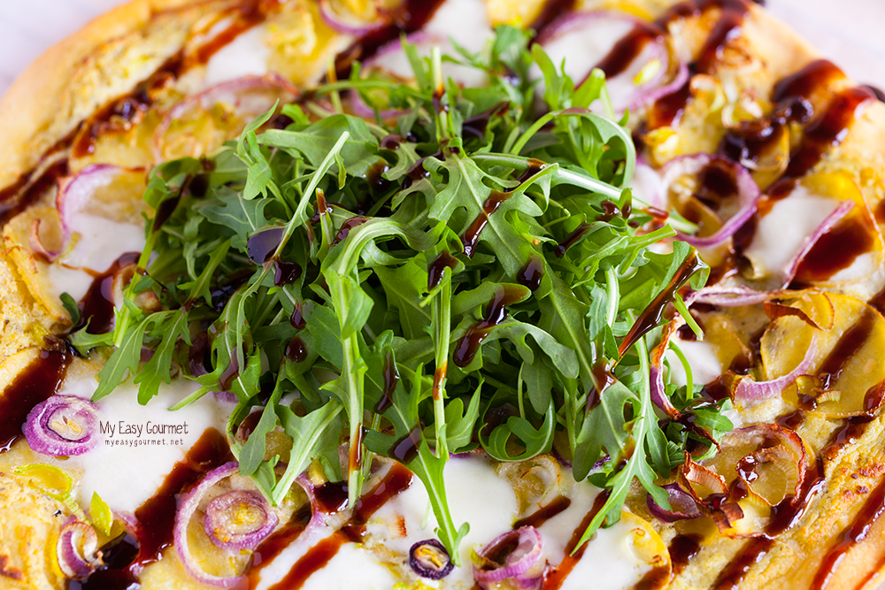 Pesto Ricotta Pizza with Potatoes, Leek, Red Onion and Fig flavoured Balsamic Cream