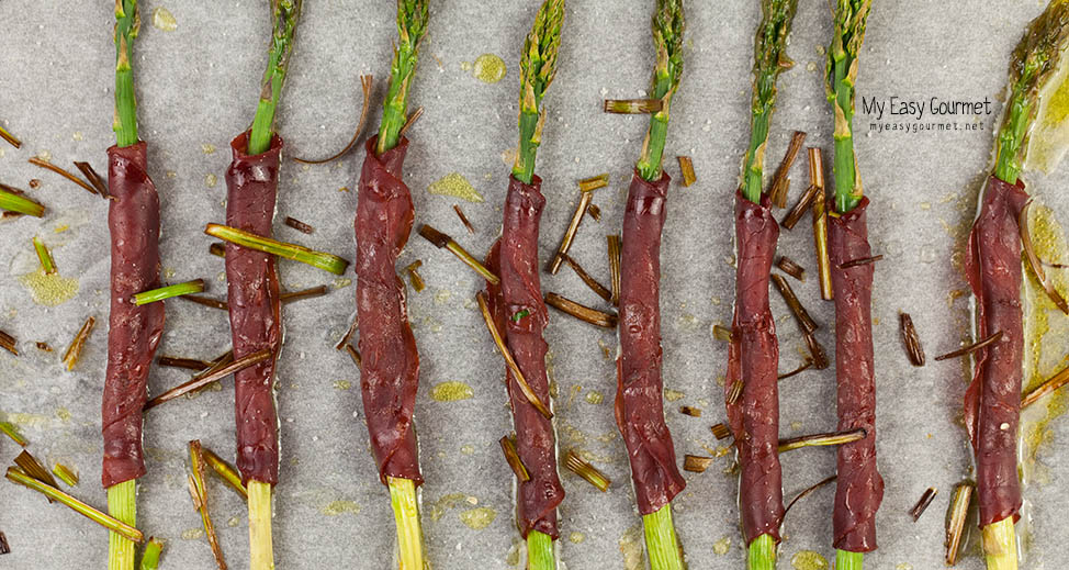 Asparagus wrapped in bresaola slices
